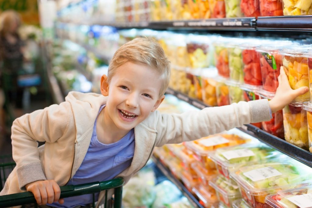 boy in a grocery shopping cart