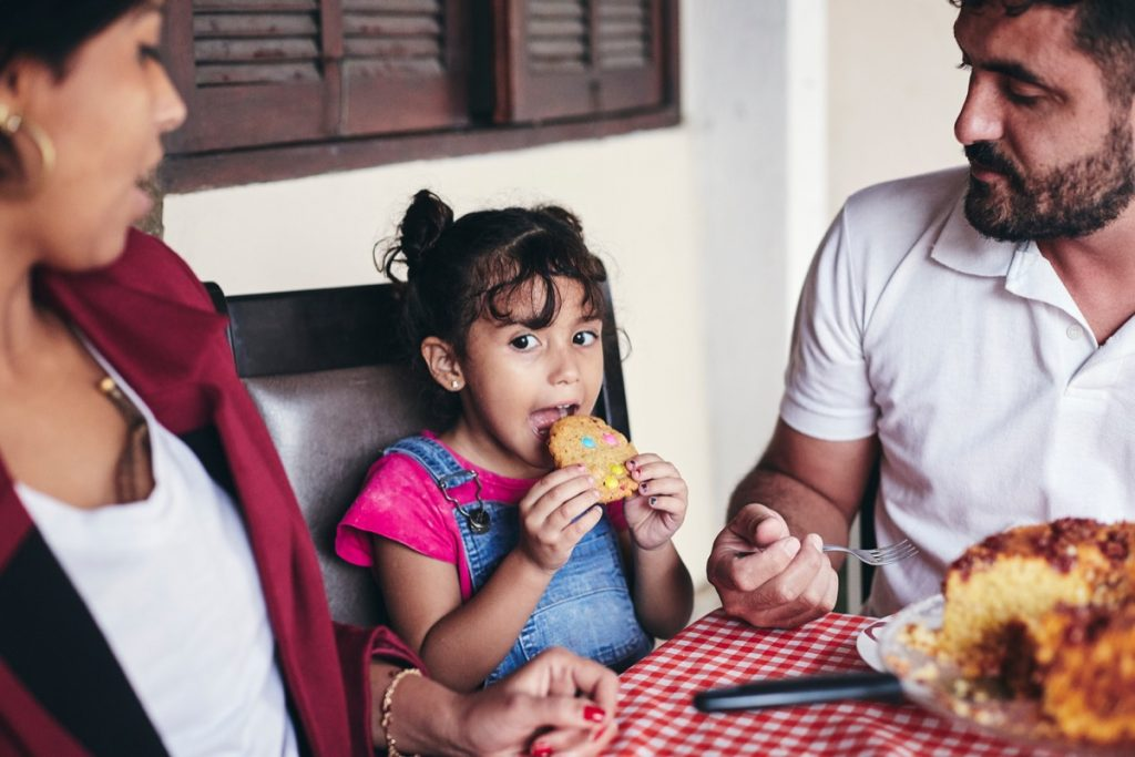 Kid Eating with Parents