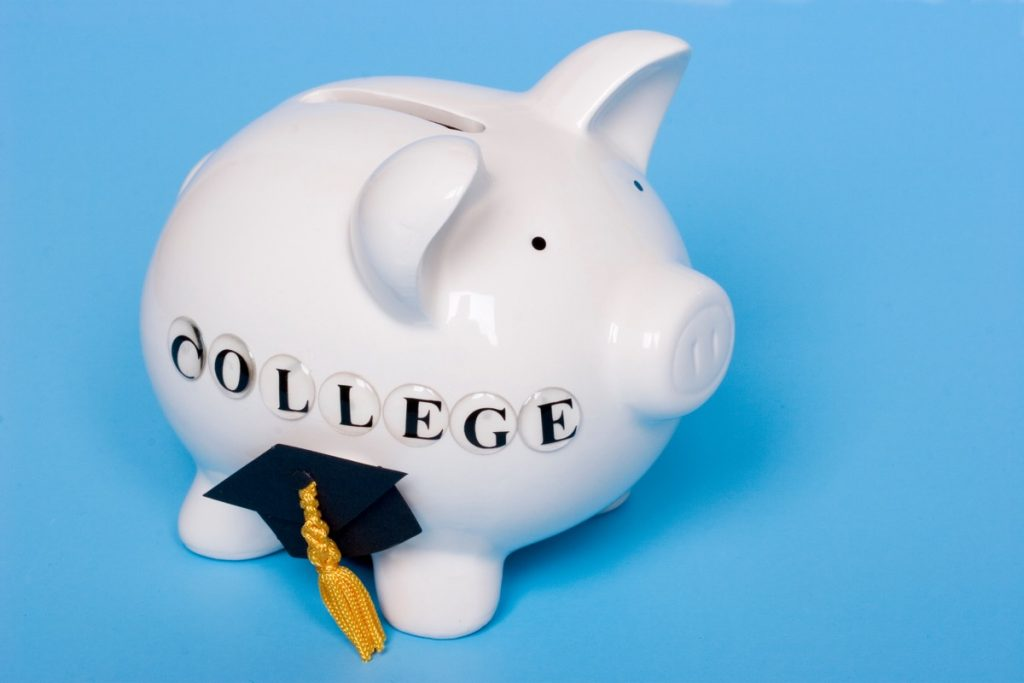 Saving for college - piggy bank with grad cap