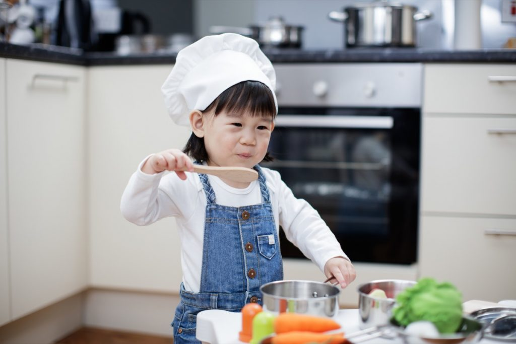 Child cooking food