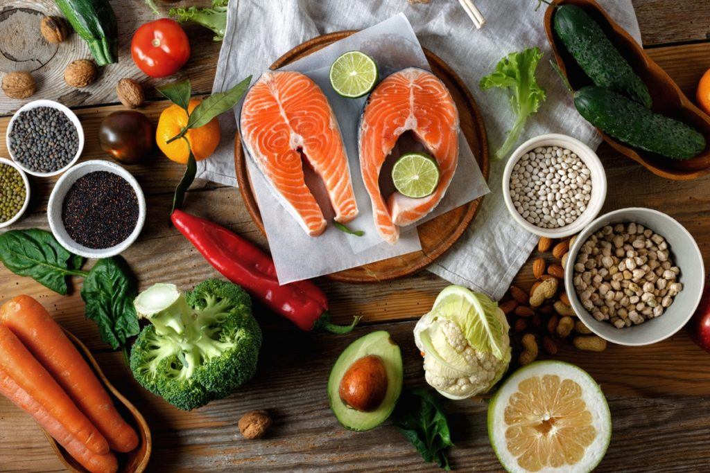 Healthy foods such as salmon, broccoli, carrots